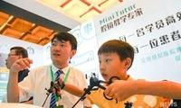 华西医院自主研发智能腔镜培训及考核系统亮相首届中国模拟医学大会