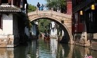 穿越水乡的千年时光,轻声流淌在水巷古桥之上